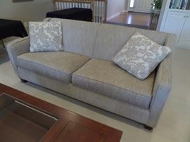 Couch and loveseat are more of a beige/tan color!  Very clean and in excellent condition.