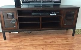 Modern style entertainment center. Less than one year old. Pristine.
