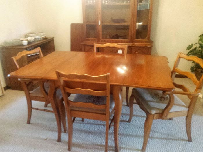 French Country drop leaf dining table w/4 chairs.  Each chair has a handmade needlepoint seat.