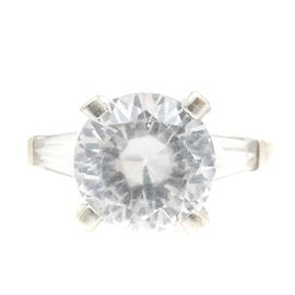 0c48aef06f0 14K White Gold White Sapphire and Topaz Ring: A 14K white gold ring  featuring a