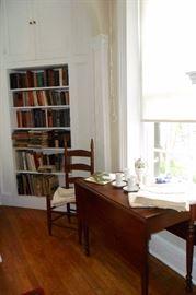 Antique Drop Side Table,Antique Ladder Back High Chair, rush seat. Linens,Books. Tea Set.