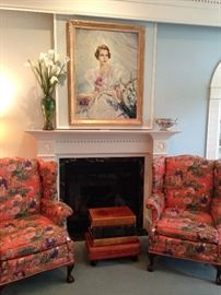 Two wingback chairs upholstered with Asian print fabric; book stack side table;