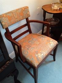One of the dining table upholstered chairs