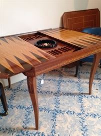 Versatile game table has several different tops