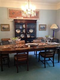 Fine dining table with 8 chairs; antique breakfront; framed silk panel