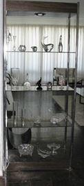 beautiful glassware on glass and chrome shelf