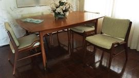 Brown Saltman dining room table, chairs with leaves