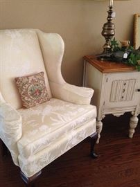 One of two Queen Anne style wingback chairs; small Shabby Chic side table