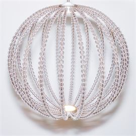 Modern LED Light Fixture: A modern LED light fixture. This light is composed of multiple strands of clear plastic bubble beads on metal strands. The LED light is in the center on the top and bottom.