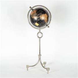 Nicholson-Hardie Magellan Globe: A Nicholson-Hardie Magellan globe. This globe has a silver-tone metal stand with tripod feet. The globe is on a rotating axel.