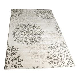 Feizy Import Area Rug: A Feizy Import area rug. The rug is made of 80% wool and 20% cotton. It is made in India. It is off white with light grey to black floral medallions.