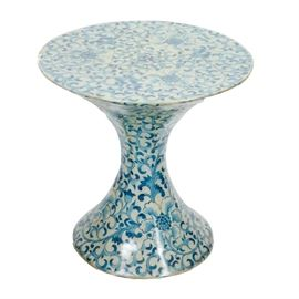 Decorative Fiberglass Accent Table: A decorative fiberglass table. This table has an hour glass shape. It is white with a blue floral design.