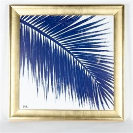 "Framed Print Titled ""Indigo Baru Palm II"" by Pinto: A framed print titled Indigo Baru Palm II by Pinto. This print depicts a blue palm leaf in a brushed gold tone wooden frame. It is signed in the bottom corner."