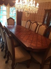 Tuscan 10 foot inlaid dining room table with 10 chairs columns and wought iron