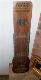 antique ukelin instrument made by International music corp