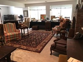 Persian rugs, wing chairs, hand-made Mexican furniture