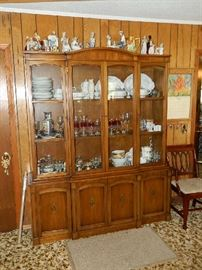 Drexel China cabinet loaded with fine china, vintage glassware, crystal, and Lladro figurines on top of cabinet