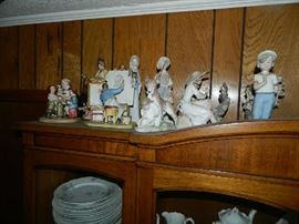 More Lladro, Norman Rockwell, and other pieces.  A great set of Limoge china also in Cabinet.