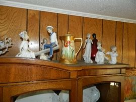 View of Lladro figurines, Hand painted Nippon, signed by artist, other figurines, and a Murano glass lamp base, you have to see to believe all the wonderful things in this estate!