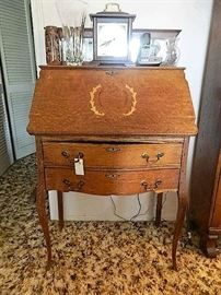 This very vintage secretary needs a little repair!