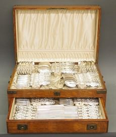 "Whiting Mfg. Co. sterling silver flatware service for twelve, ""Lily"" pattern, circa 1903, 97 pieces, in an oak case."