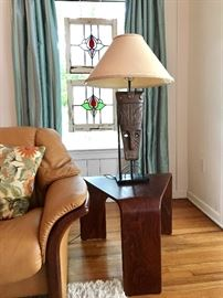 African Mask Lamp, one of a pair; Stressless wedge end table, one of a pair.