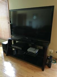 Sharp Liquid Crystal TV Model LC-C6077UN With Great TV Stand Blue Ray Player and Speakers