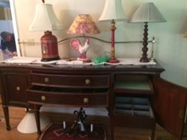 lamps, sideboard with brass gallery and tinned lined drink drawer