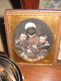 we will be taking sealed bids only on this hand tinted daguerreotype. it is 1/4 plate signed E. S. Dodge