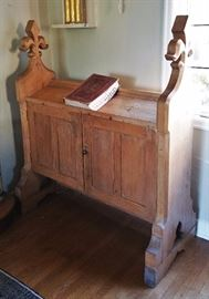 Solid, thick pine antique book stand with fleur-de-lis buttressed ends - likely from a church foyer