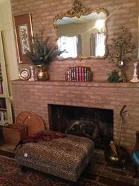 Framed mirror, leather bound books, large ottoman (as is), and other striking decor
