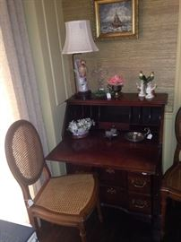 Small antique secretary; one of four cane chairs