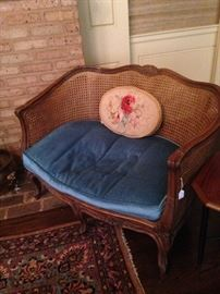 Cane French settee with blue cushion
