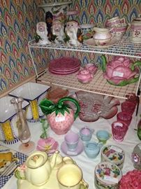 Variety of colorful tea sets, cups, and saucers