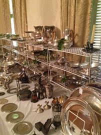 A variety of sterling and silver plate serving pieces