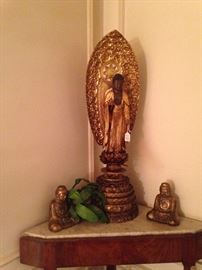 Buddha with gilt wood statue (center)