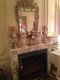 Marble mantel elegant selections; above - fabulous antique mirror