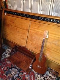 Full bed; antique shelf; vintage guitar