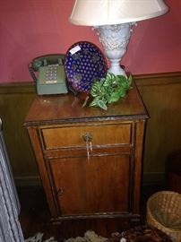 One of two matching nightstands and lamps