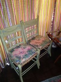 Two of four painted chairs