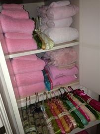 Many towels and padded hangers