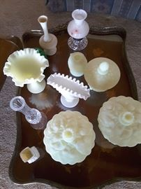Yellow beige Milk Glass candy dishes, nut dishes with covers, one candle holder, several glass vases, one ruffle white Milk Glass vase. Crystal vase.