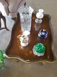 Living Room beautifully inlaid side table. Collectibles - oil lantern, blue decorative Austrian box and lid, green small vase with Dollie, ceramic pottery vase,pitcher, and tall crystal vase.