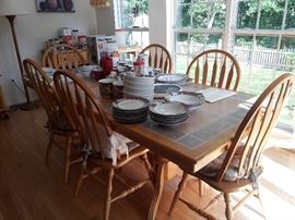 Tile top kitchen table, 1 leaf 6 chairs and 2 matching rolling buffets/sideboards