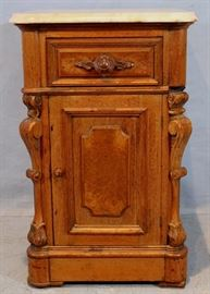 099a  Walnut Victorian half commode with original marble top and wood carved pulls, 29 in. T, 19 in. W, 18 in. D.