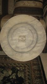 Made in Italy imprint on bottom of round table and matching oval marble top table
