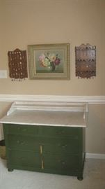 Marble top side board with raised shelf and drawers, painting, souvenir spoons on racks