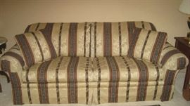 Upholstered Clayton Marcus sofa with pillows