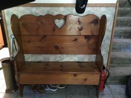 Wooden bench with storage under seat .