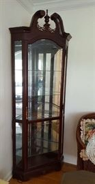 Pair of lighted corner display cabinets.